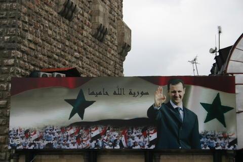 صورة منافسة حادة في الانتخابات السورية بين الأسد
