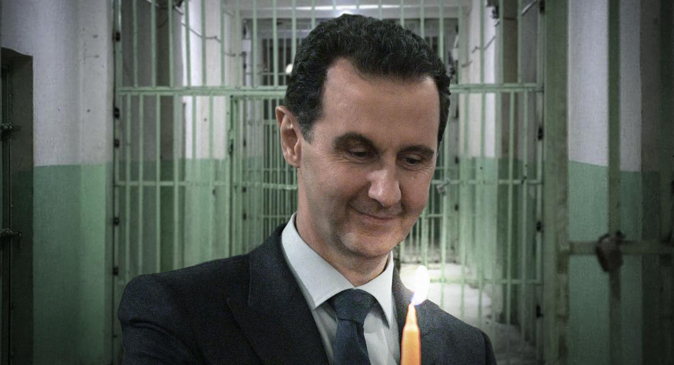 صورة بشار الأسد يطفئ شمعة السنة العاشرة للثورة في أجساد المعتقلين