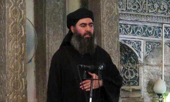 """صورة البغدادي يدعو أتباعه لشراء النسخ الأصلية من إصدارات تنظيم """"دولة الخلافة"""""""